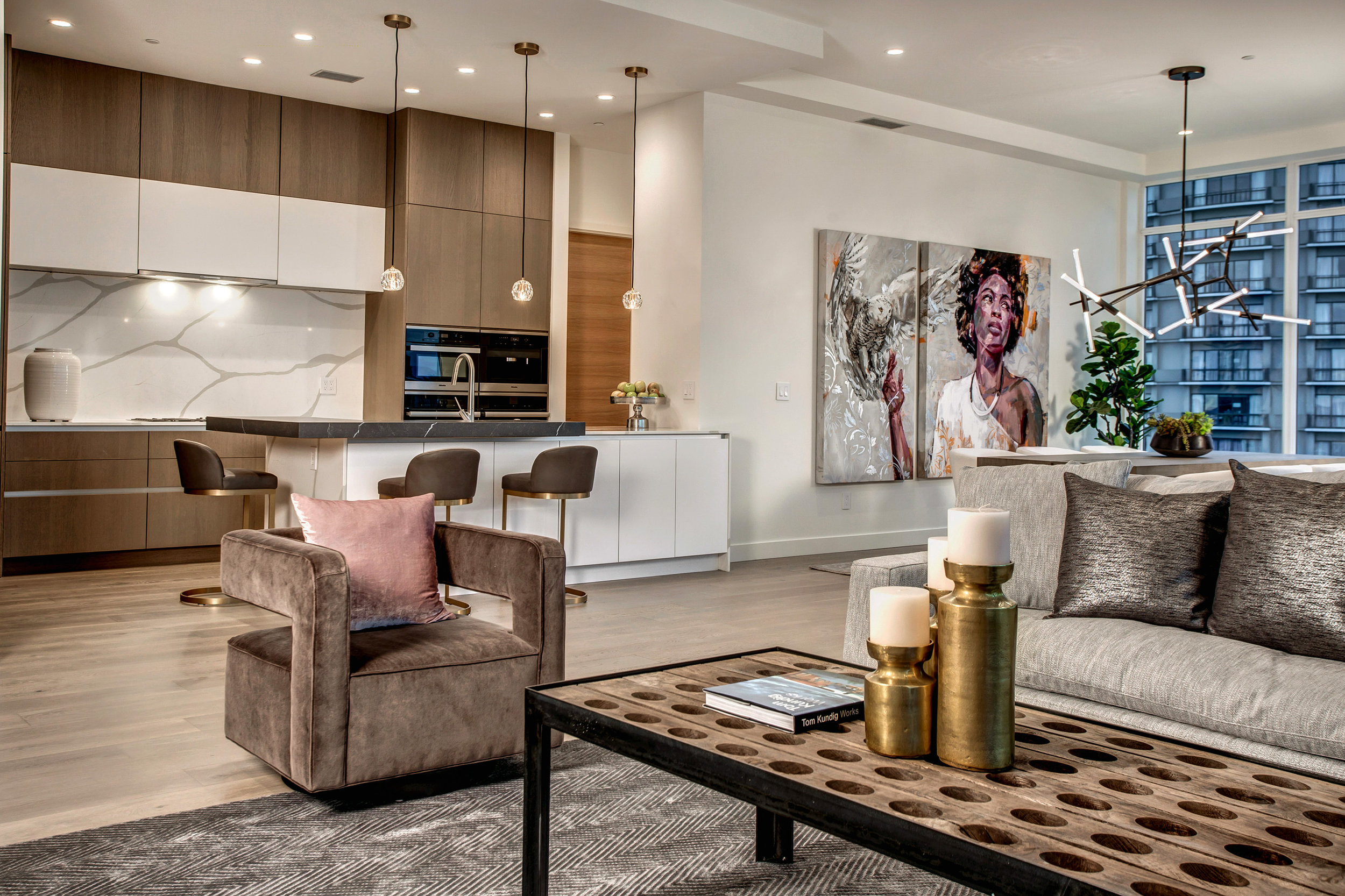 View of the open living, dining, and kitchen area. Modern contemporary design and details throughout.