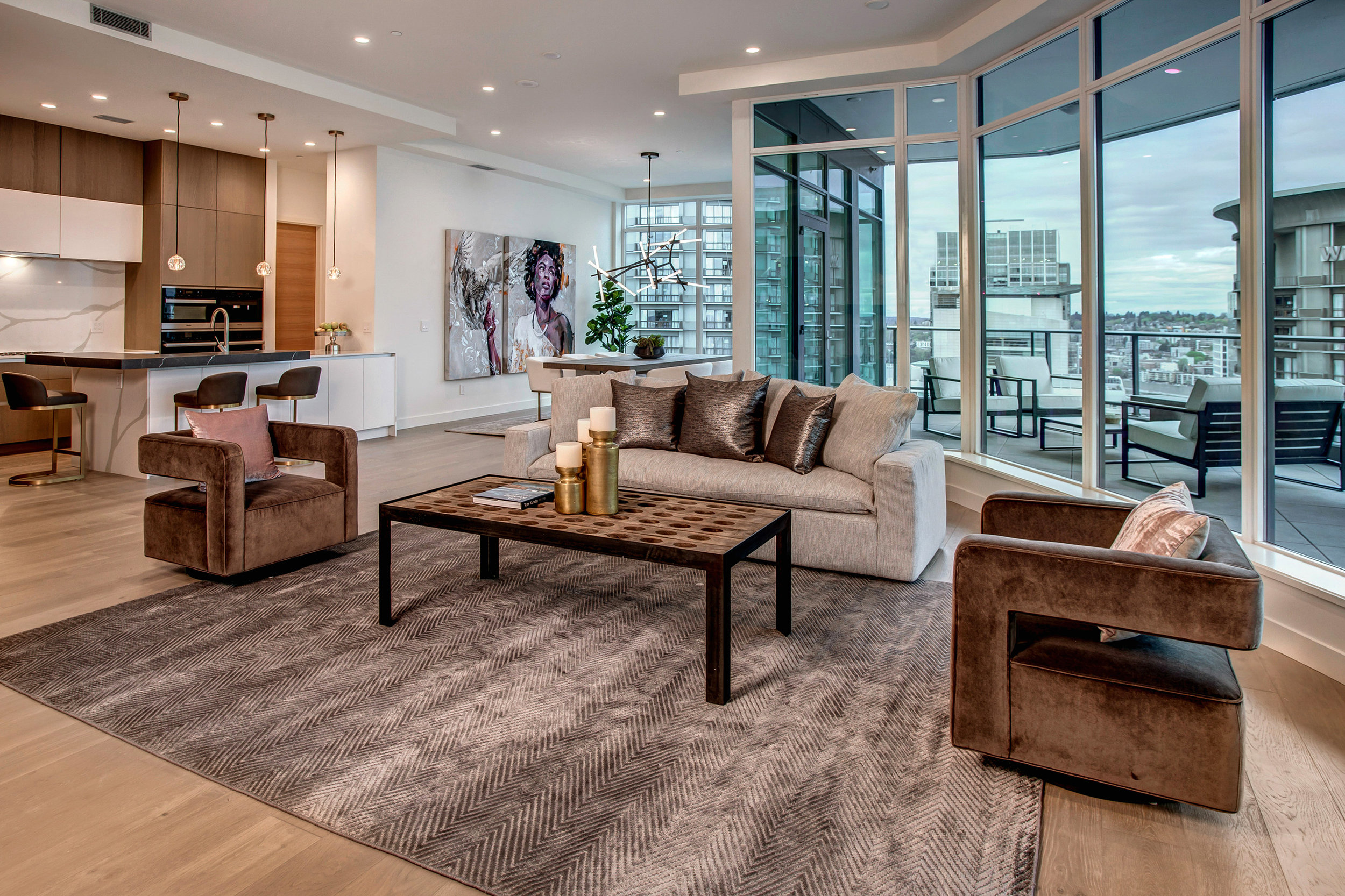 Great room with open floor plan leads to a massive entertaining balcony.