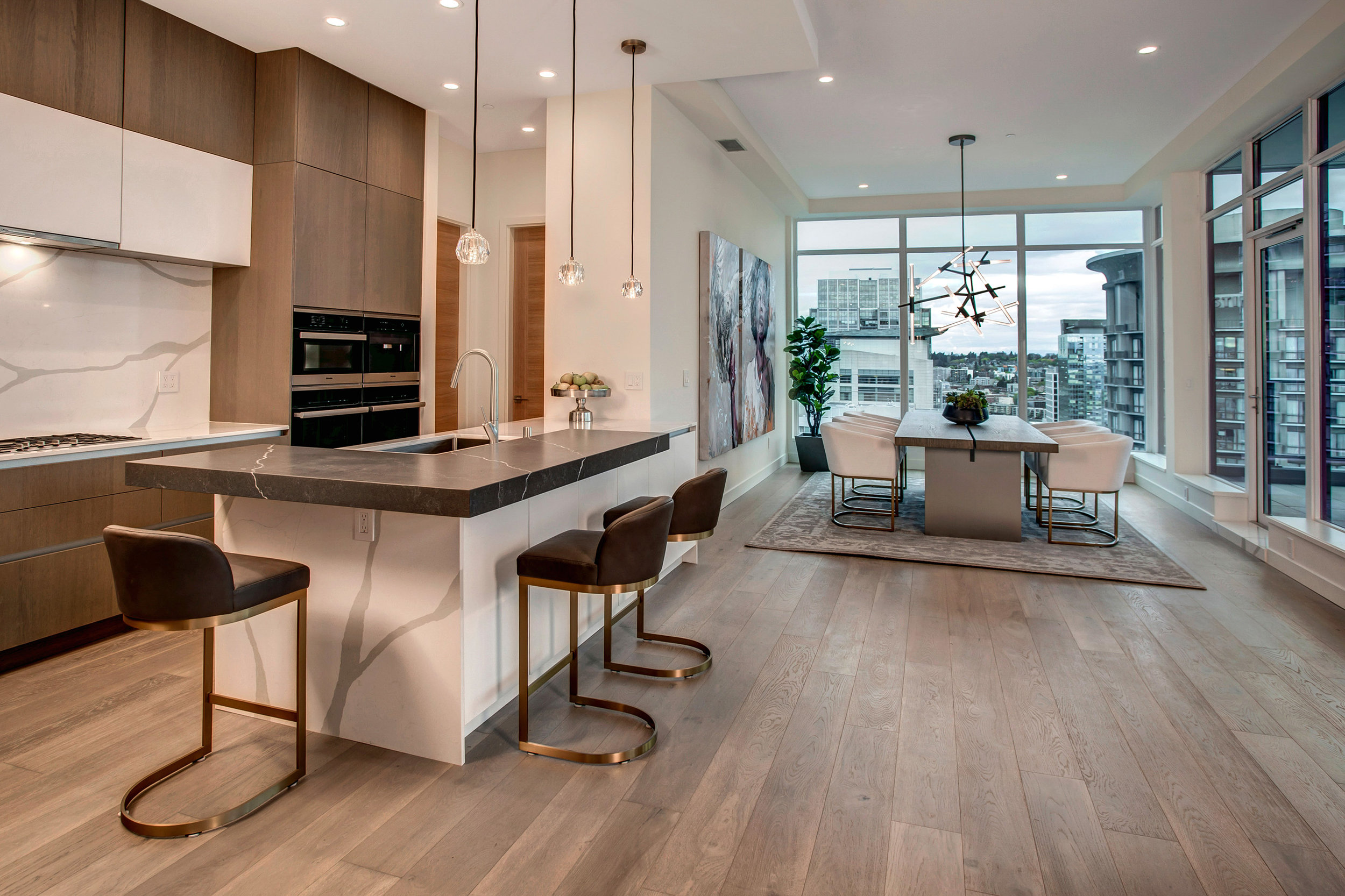 Efficient and modern kitchen with European style cabinetry.
