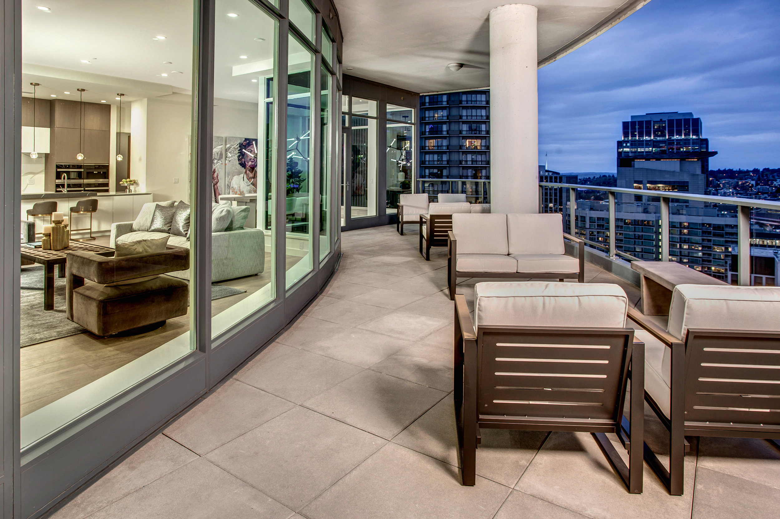 Expansive covered balcony with south and southeast facing views of the city's historical district, Cascade mountains, and Puget Sound.