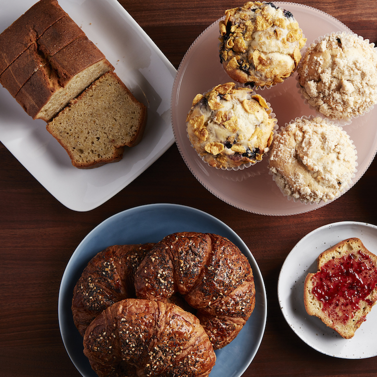 Pictured: Pistachio-Cardamom Bread, Everything Croissants, Blueberry Cornflake Muffins, Coconut Chocolate Chip Muffins.