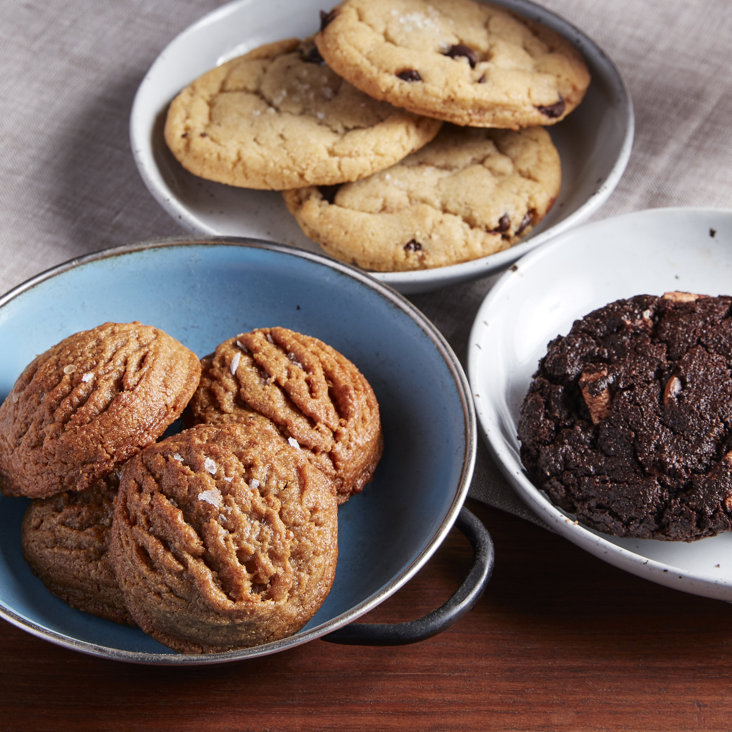 Pictured: Salted Peanut Butter Cookies, Salted Chocolate Chip Cookies, and Hot Chocolate Cookies.