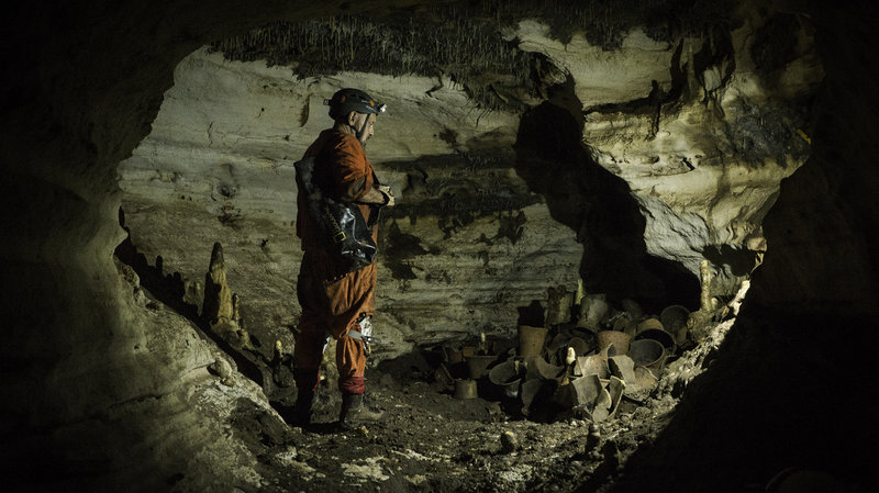 Archaeologist Guillermo de Anda checks out the third group of discovered archaeological materials in the cave. Courtesy of Karla Ortega