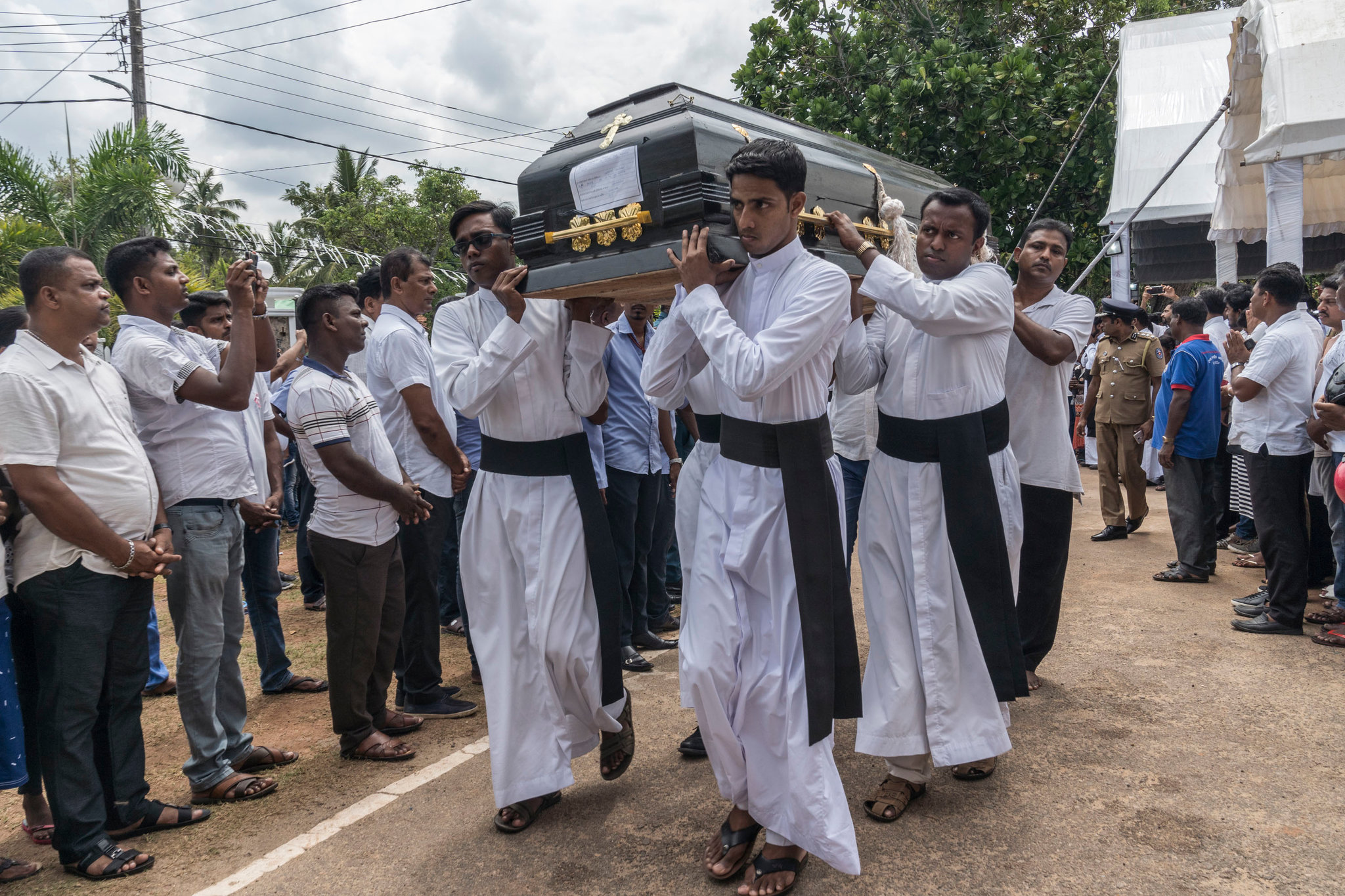 People carried coffins for burial on Tuesday after a group funeral Mass for victims of the Easter Sunday bombings, at St. Sebastian's Church in Negombo, Sri Lanka.CreditCreditAdam Dean for The New York Times