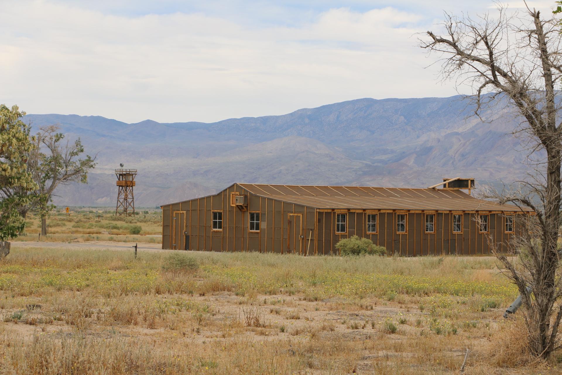 (Manzanar Guard Tower and reconstructed building. Photo Credit: Athena Mari Asklipiadis)