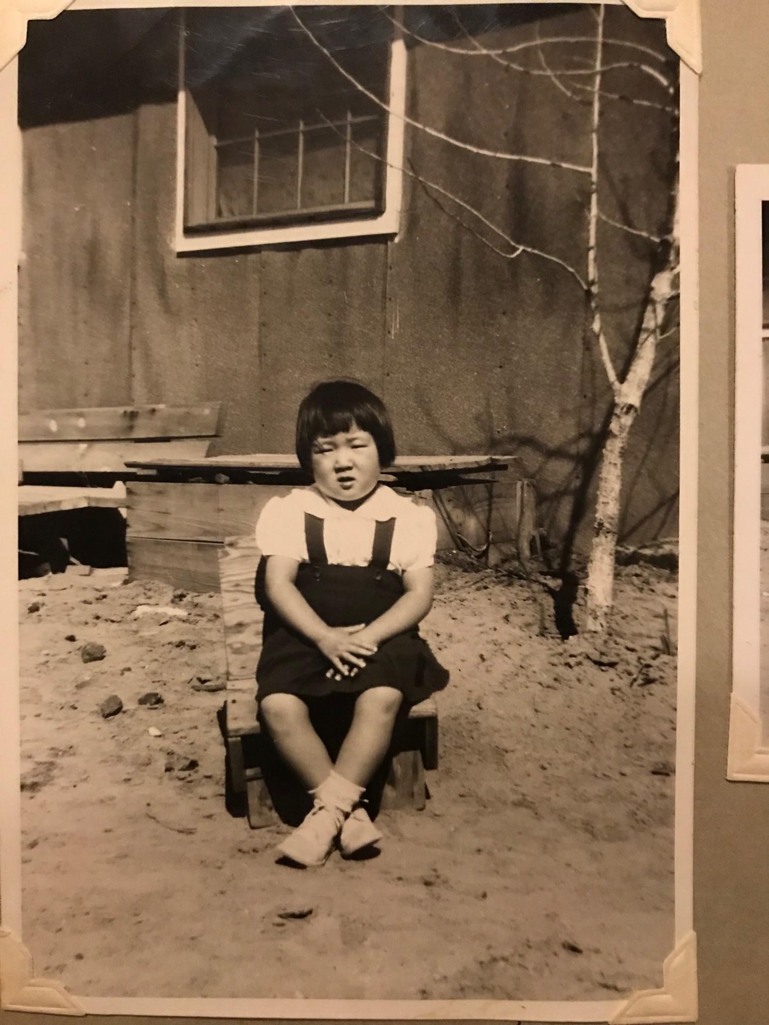 (My mother, Susan Yahiro Asklipiadis, outside of her family's barrack.Photos Courtesy of Yahiro Family)