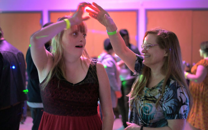 Jessica Zuback of Woodbine, Md. dances with her mother Kathy Zuback at Club 1111. (Karl Merton Ferron/The Baltimore Sun/TNS)