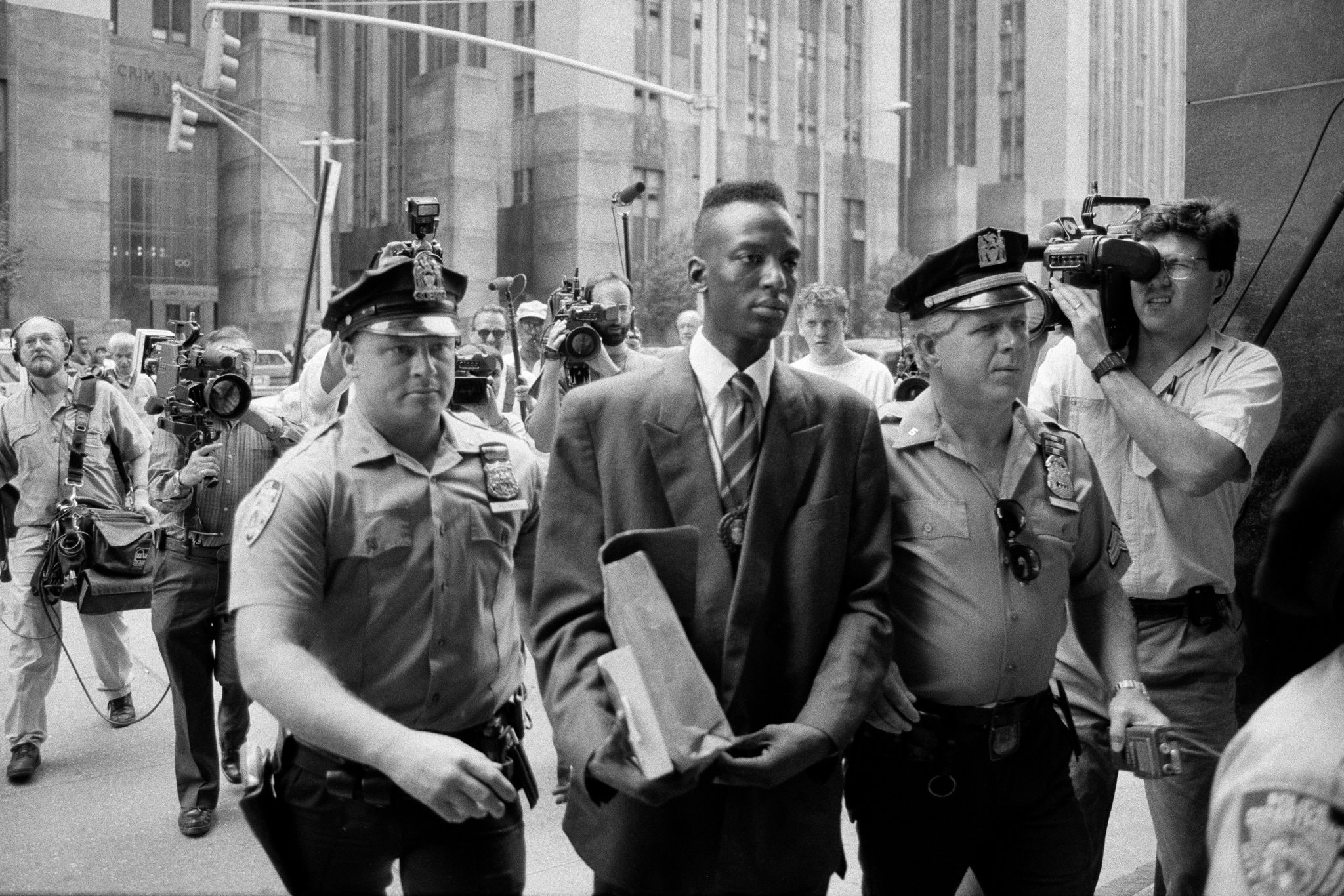 Yusef  Salaam, seen here being escorted into the State Supreme Courthouse in  lower Manhattan in 1990, was one of five teenagers who would become  known as the Central Park Five.CreditCreditJames Estrin for The New York Times