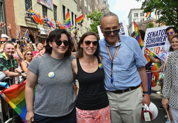 ANGELA WEISS via Getty Images  Senate Minority Leader Chuck Schumer (D-N.Y.) at the NYC Pride March with his daughter, Alison, and her wife, Elizabeth Weiland.