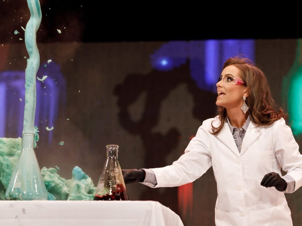 Camille Schrier, a biochemist, did a science experiment during the talent portion of the Miss Virginia pageant on Saturday.  John Herzog/Miss Virginia