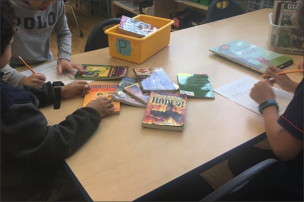In these 2017 photos, students in Noelle Mapes' 3rd grade class complete an audit of the books in their library. They tracked the racial breakdown of the main characters in the stories and determined that they were overwhelmingly white. The exercise is meant to illuminate the lack of diversity in children's literature.  —Noelle Mapes