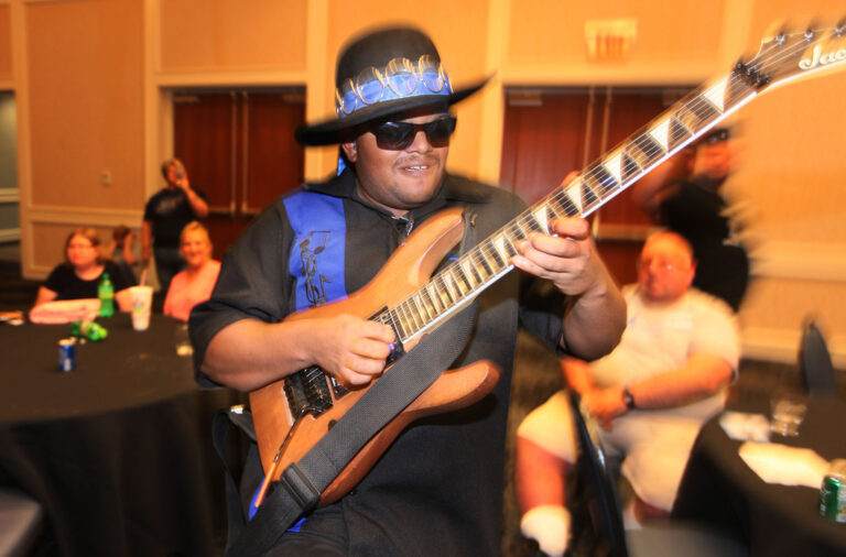 Zayne Harshaw, founder of Blue Spectrum, performs at the ARC of Ohio People First dance on July 12, 2019, at the Nationwide Hotel and Conference Center in Lewis Center, Ohio. (Doral Chenoweth III/Columbus Dispatch/TNS)