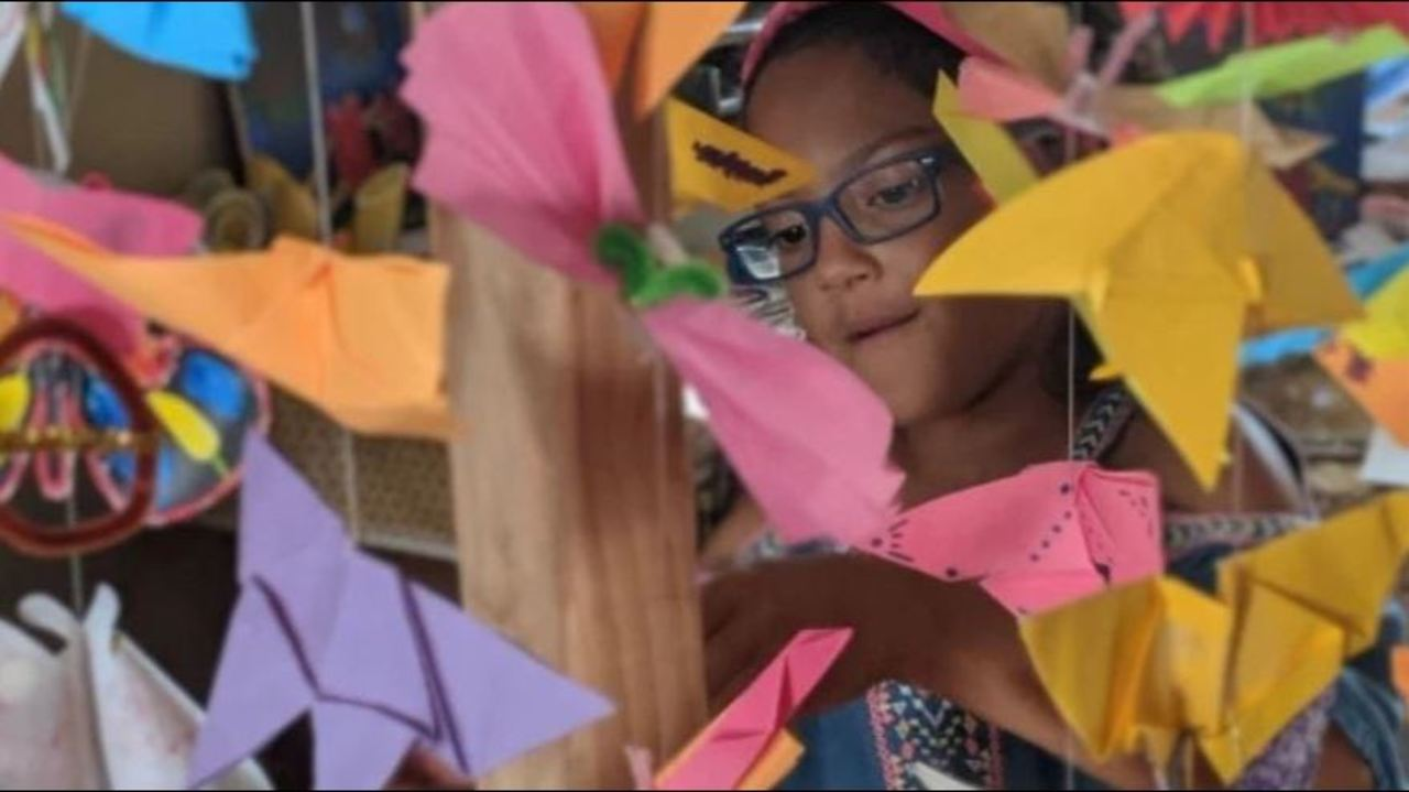 Lily Ellis, 10, stands with homemade butterflies to represent migrant children in U.S. detention facilities. Her goal, along with friend, Kaia Marbin, 11, is to create 15,000. Photo: The Butterfly Effect