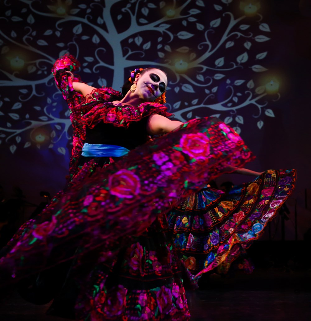 A dancer performs at the Calpulli Mexican Dance Company's annual