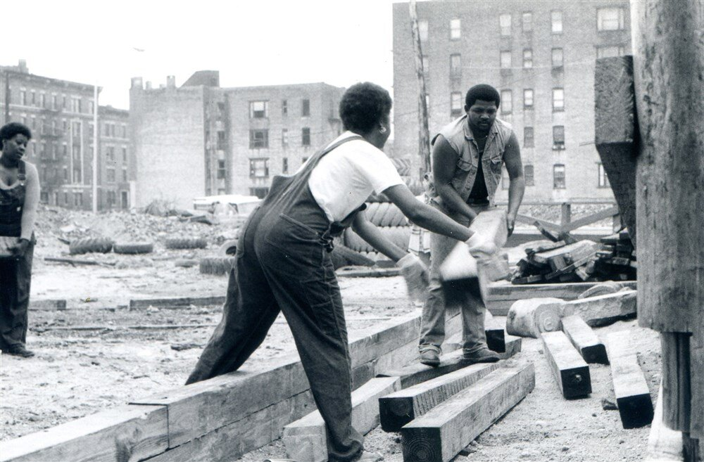 Robert Foster and a woman moving beams on Kelly Street. Foster is the former executive director of Banana Kelly, which rehabilitated South Bronx apartment buildings into affordable and livable housing.Courtesy of Eric Wingate