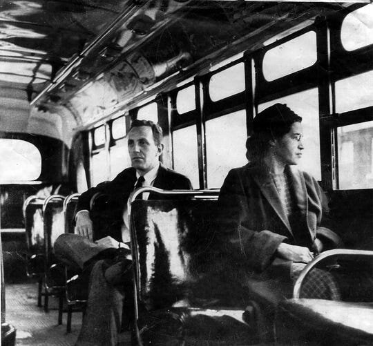 This is an undated file photo of Rosa Parks riding on the Montgomery Area Transit System bus. Parks refused to give up her seat on a Montgomery bus on Dec. 1, 1955, and ignited the boycott that led to a federal court ruling against segregation in public transportation. (Photo: AP Photo)