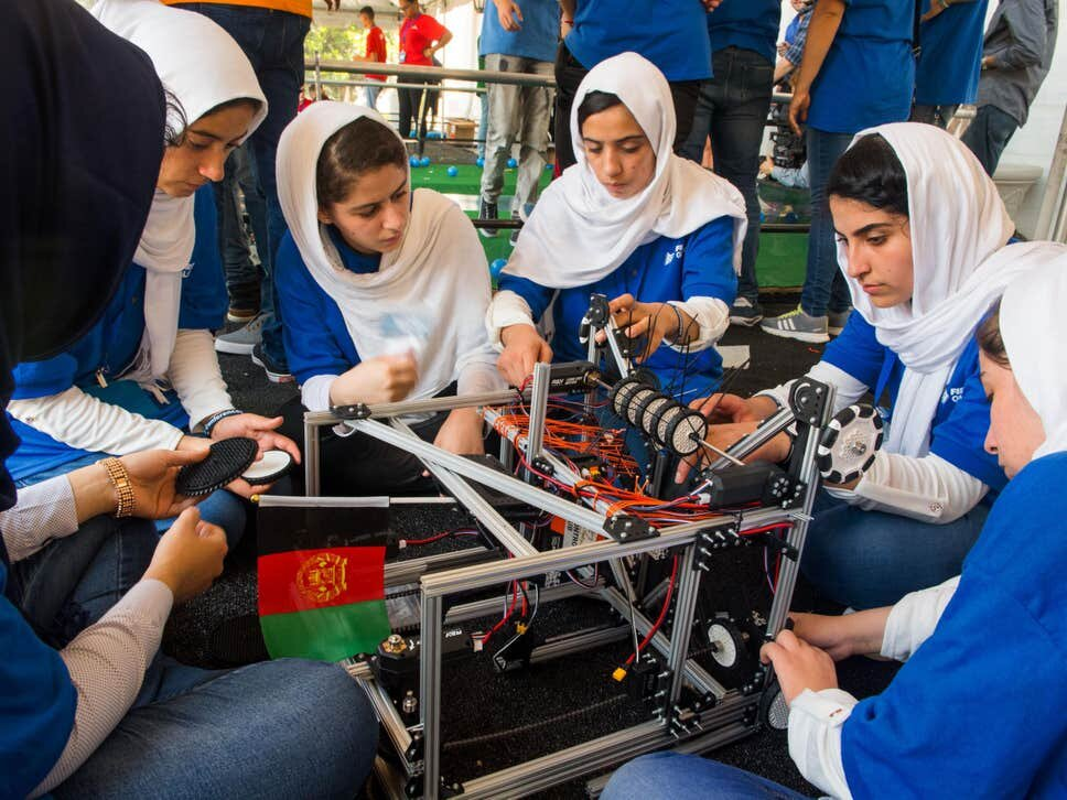 Members of the Afghan all-girls robotics team make adjustments to the team robot in the practice area on July 17, 2017   ( PAUL J RICHARDS/AFP/Getty Images )