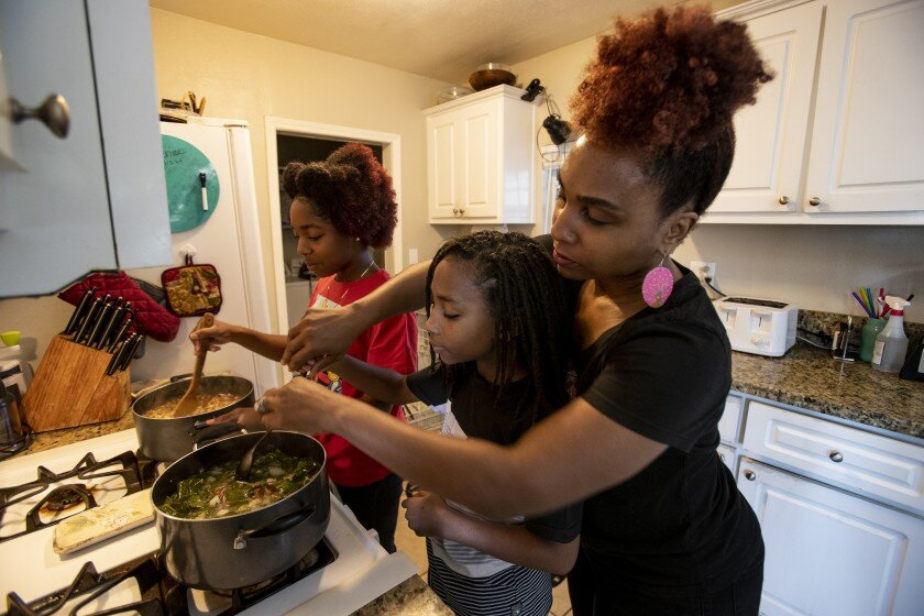"""It's a spiritual moment,"" said Layla Sewell, right, of cooking her ancestors' recipes with her children.    (Gina Ferazzi / Los Angeles Times)"