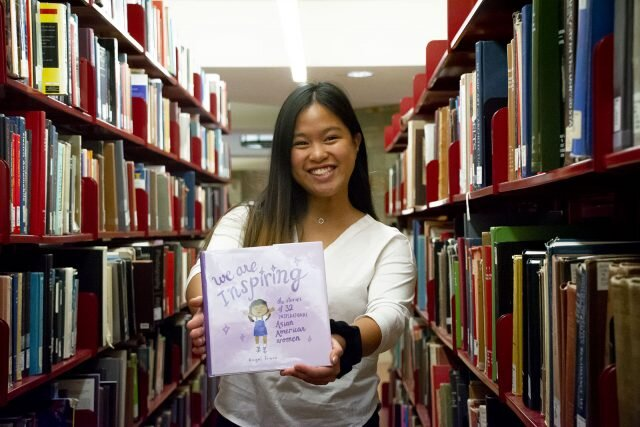 "Graduate student Angel Trazo said there is an issue with diversity in  children's publishing. To help combat this problem, she self-published a  children's book entitled ""We Are Inspiring: The Stories of 32  Inspirational Asian American Women,"" which includes Trazo's  illustrations of the women alongside a brief biography describing their  backgrounds and contributions to society. (Sakshi Joglekar/Daily Bruin)"