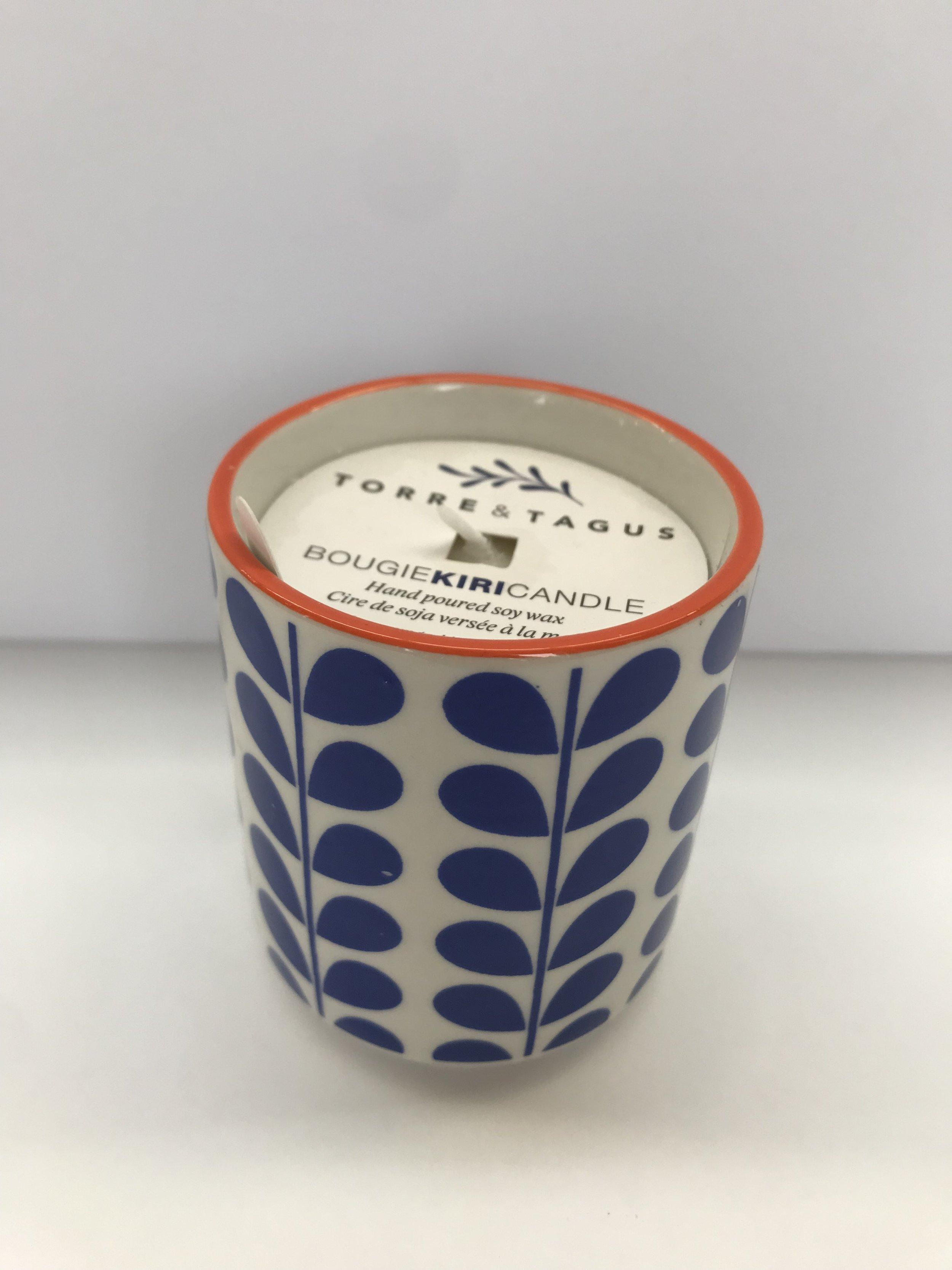 "Blue Vine Votive Candle (Unscented) - Colour: Orange / White / BlueDimensions: 2.5"" Diameter x 3"" HPrice: $10.00 + HSTSale Price: $7.00 + HST"