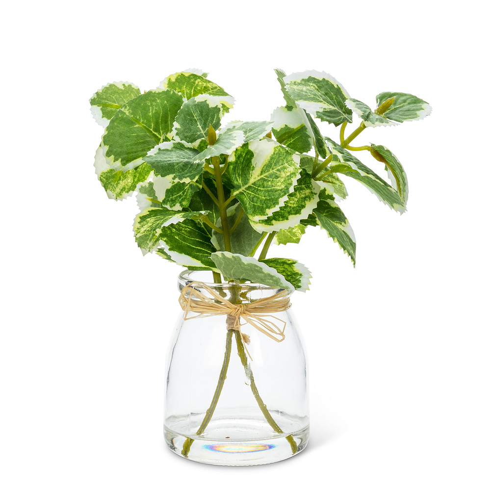 Varigated Greenery Vase - This vase with variegated greenery makes a wonderful complement to other colourful flowers and plants. Made of polyester with an elegantly simple glass vase, this authentic-looking collection of greenery is sure to brighten any room, from the office to the home or cottage — without the mess or maintenance of an actual plant.Regular Price: $13.00 + HSTSale Price: $10.40 + HST