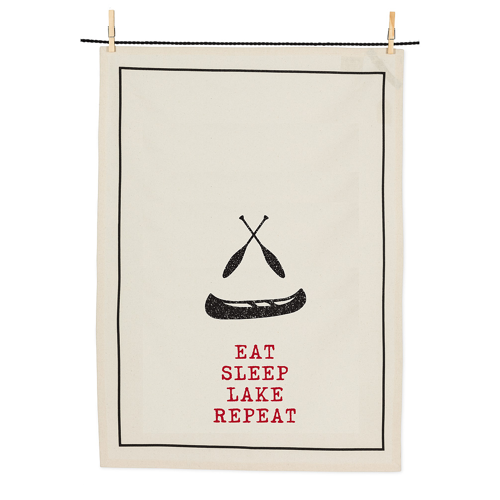 """Eat, Sleep Canoe Tea Towel - Our decorative """"Eat, Sleep, Lake, Repeat"""" tea towels aren't just decor; they're also words to live by! Part of the Cottage Life Weekend Collection, this 100% cotton, machine-washable ivory tea towel features a graphic set of oars and canoe to accent this cottage-living mantra.Regular Price: $9.99 + HSTSale Price: $7.99 + HST"""
