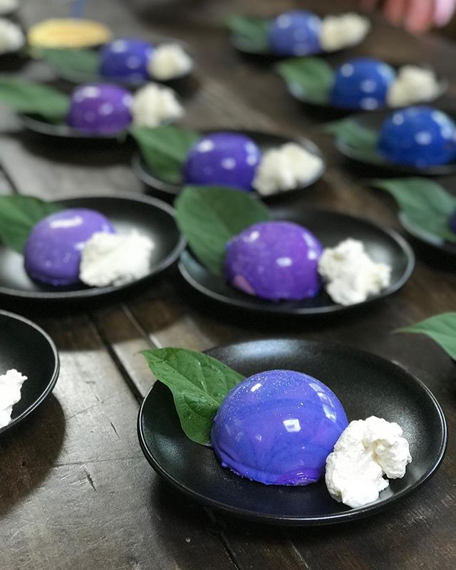 Galaxy mousse cakes with clouds of cream in honor of a giant mirrored hot air balloon event