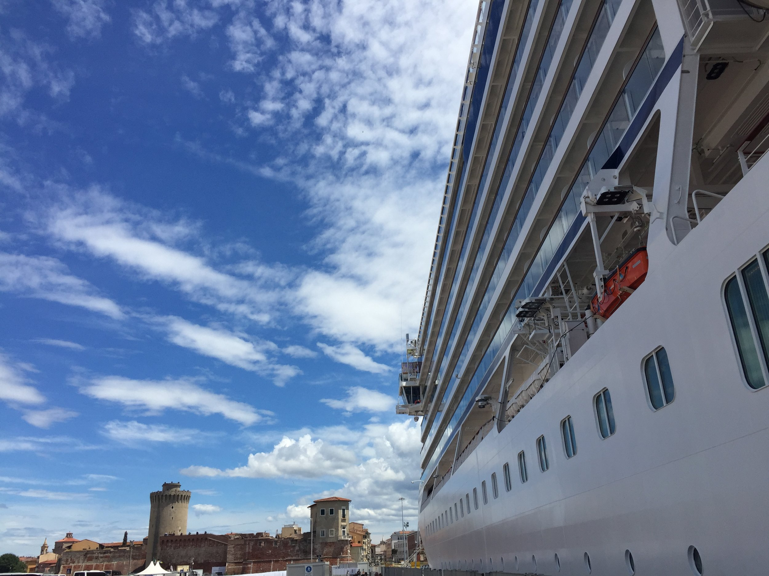 Viking Orion's modern lines next to Livorno's old port fortress