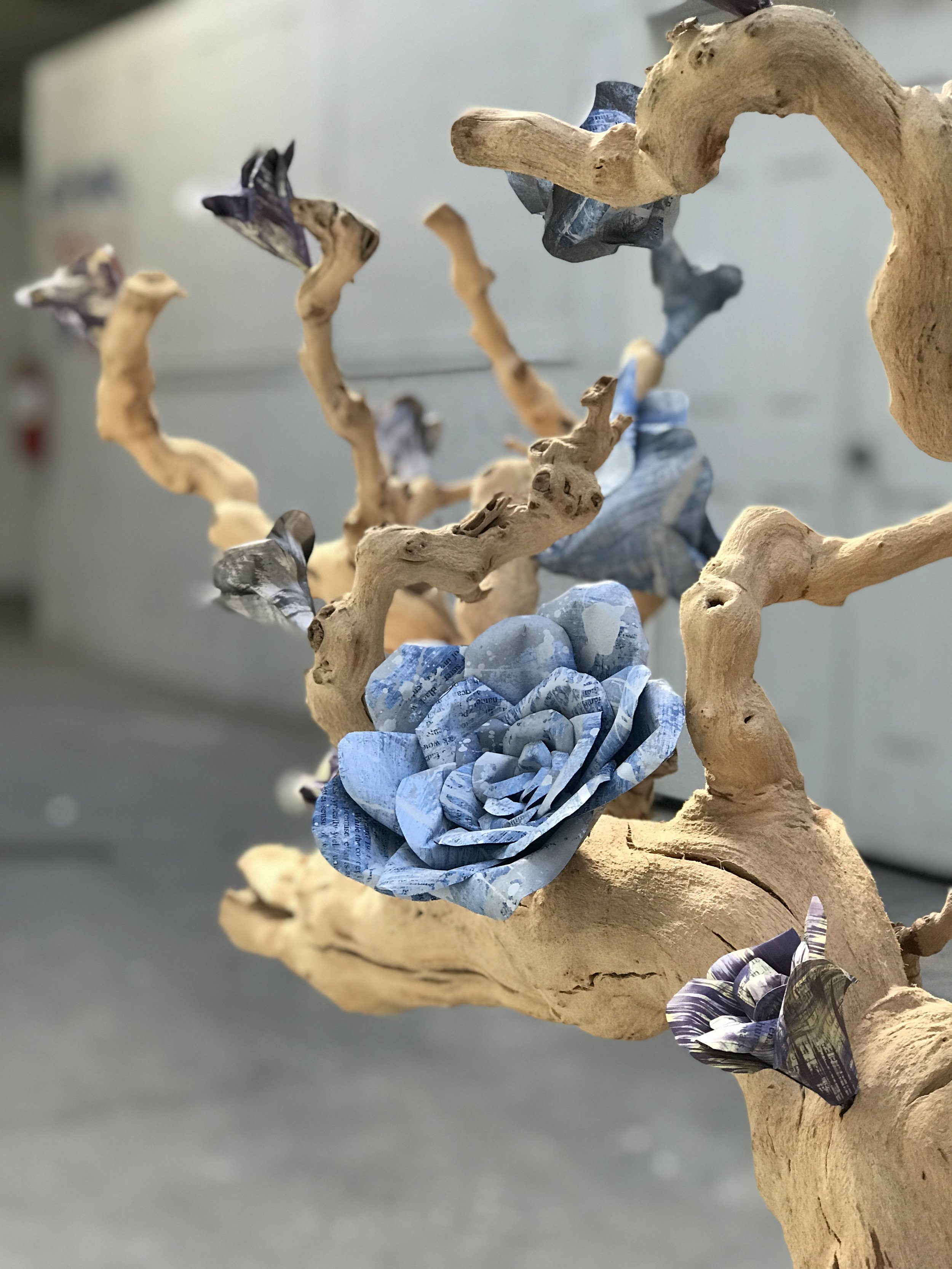 This flower is made from recycled books. they are hand painted and assembled