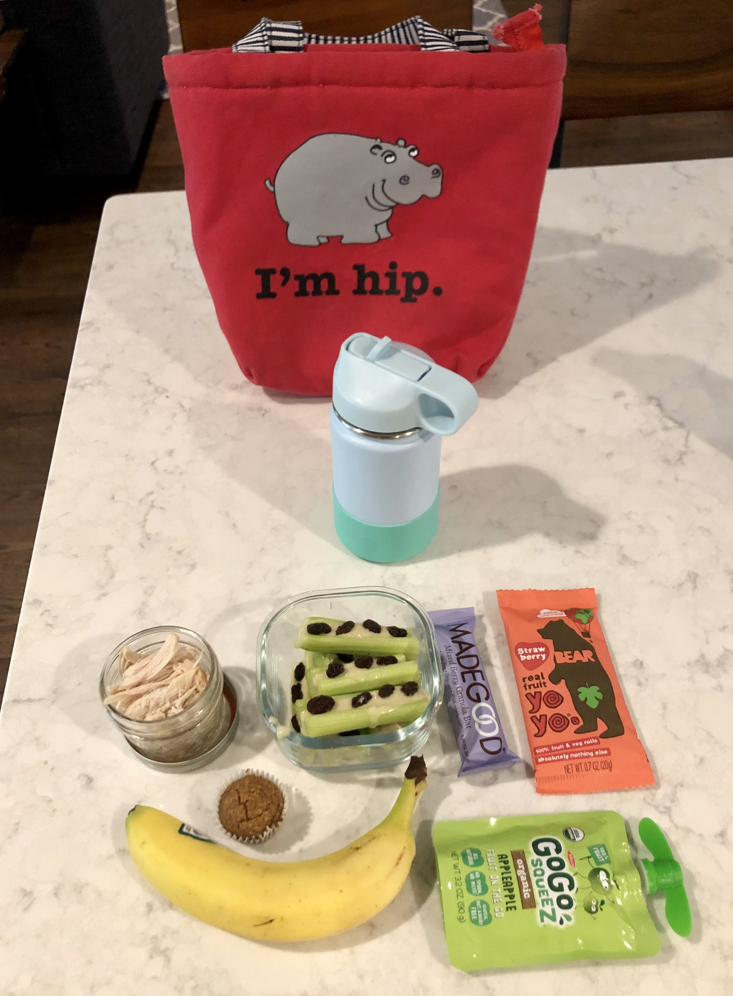 """Monday   -Shredded chicken -""""Ants on a log"""" -Made Good Bar -Fruit and veggie roll-up -Banana muffin -Banana -Apple Sauce -Water with probiotics"""