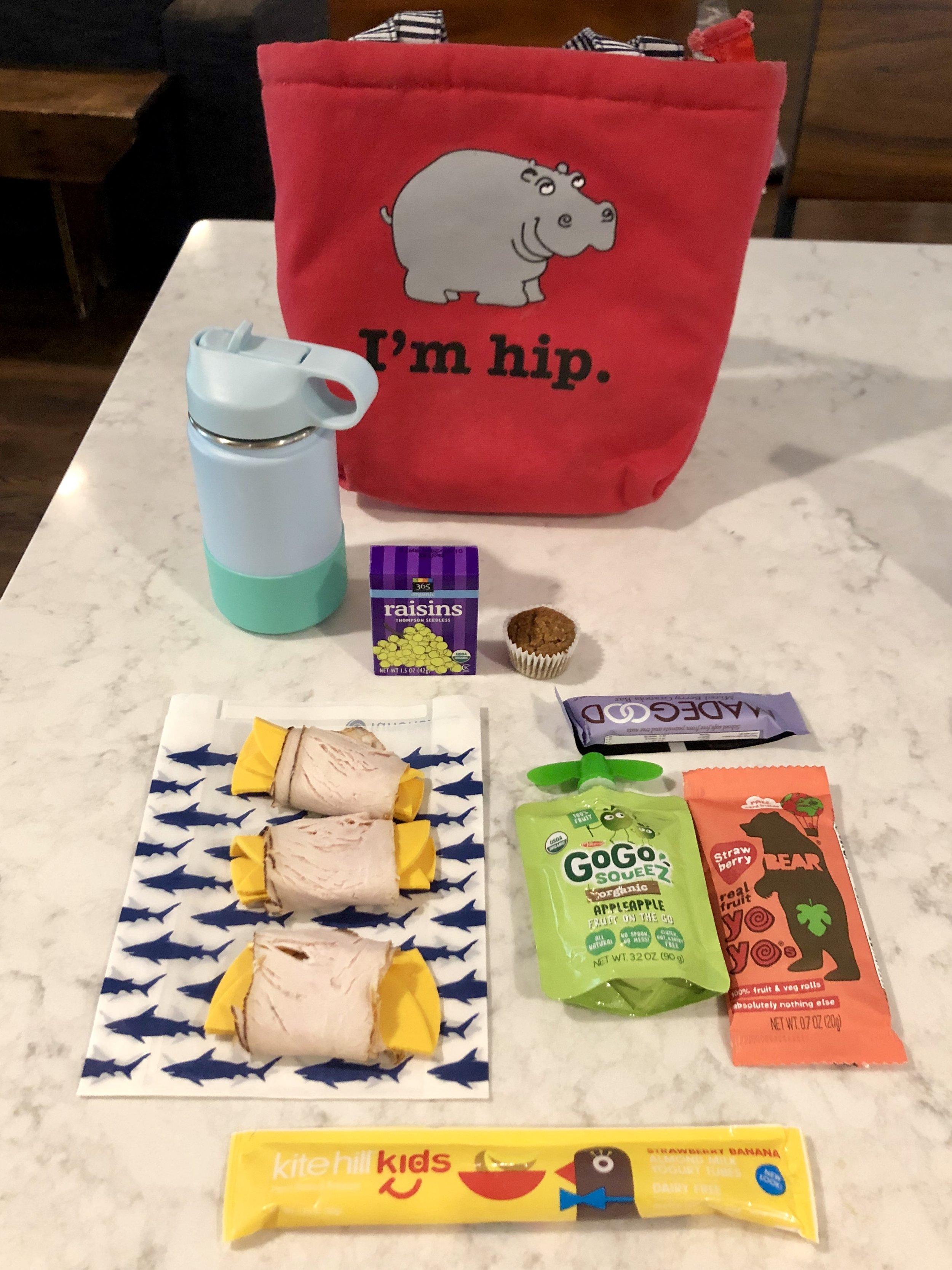 "Wednesday   -Turkey and ""cheese"" wrap -Raisins -Almond milk yogurt squeeze -Made Good Bar -Fruit and veggie roll-up -Banana muffin -Banana -Apple Sauce -Water with probiotics"
