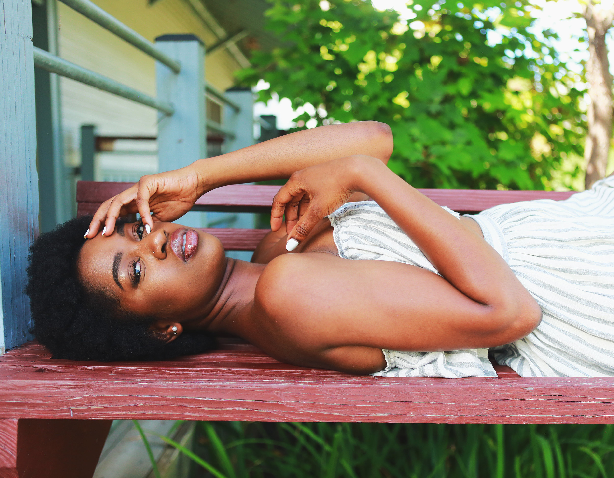 Canva - Woman Lying on Brown Wooden Bench.jpg