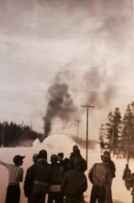 Children watching the first train of the season arrive. Yellowstone Historic Center Collections.