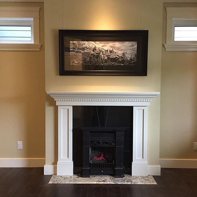 So pleased with the fireplace in the office/ salon/ formal living room . As always we have installed hanging rail of our our own design for your 🖼 . . . . . . #dreamhome #yegrealestate #edmonton #hygge #fireplace #pianowindow #dentil #yeggers #homeforsaleyeg #blackandwhite #interior #interiordesign #architecture #yeginfill