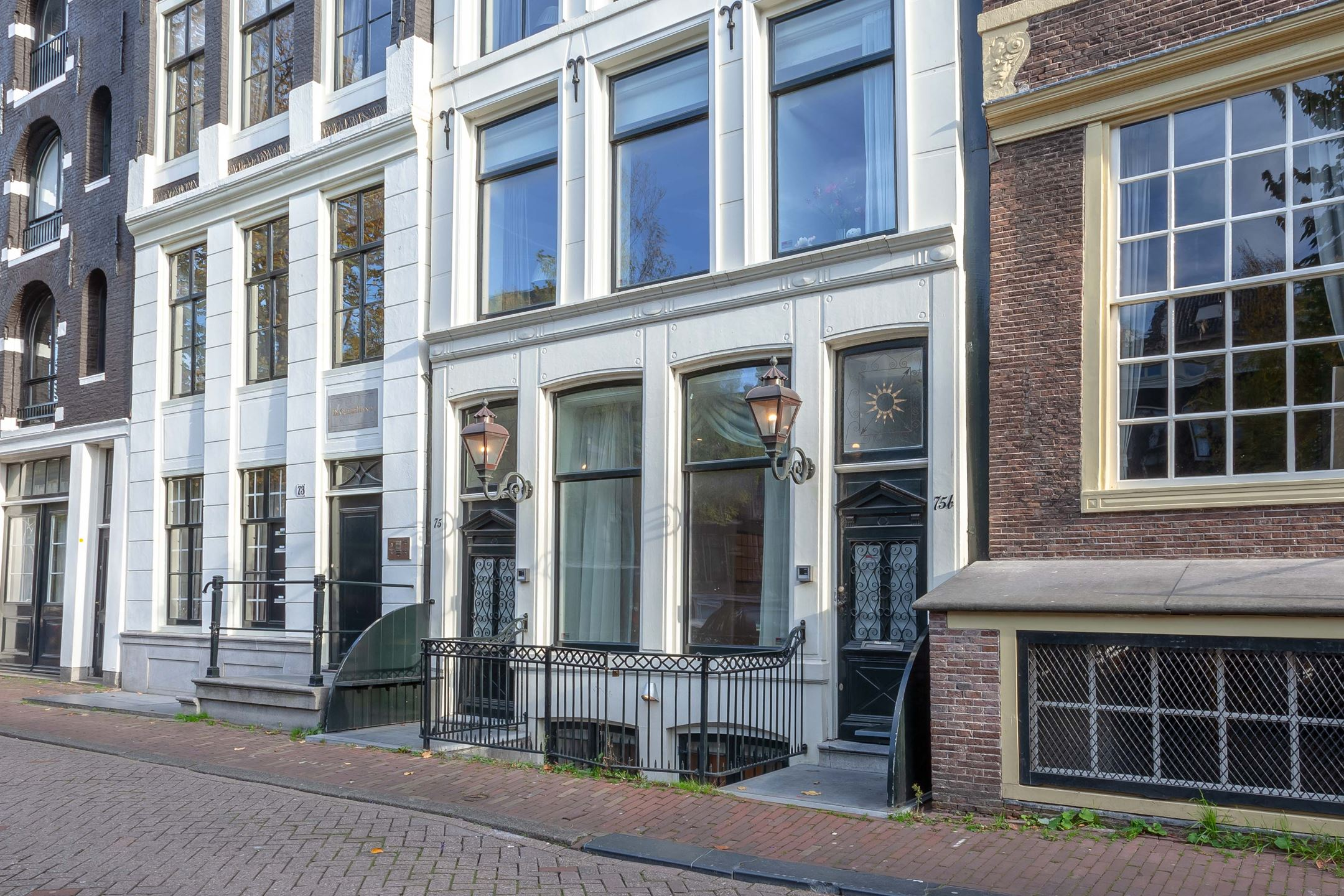 Herengracht 75hs. Our front door (under the lantern on the left) was over a hundred years old. Much of our apartment reflected a remodel made only as recently as the 1920s. During the War, the brown brick building to the right was the home of a ranking Dutch Nazi sympathizer.