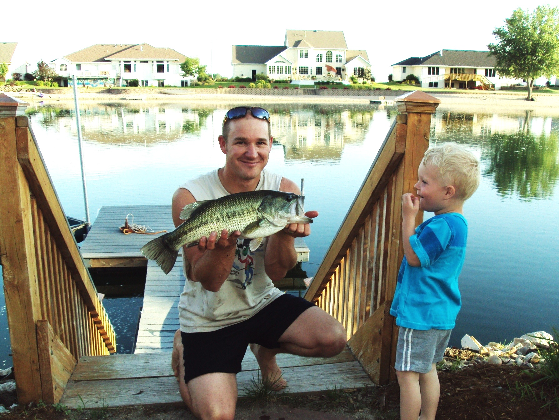 Clay and I with a nice Bass off our dock in Grand Island