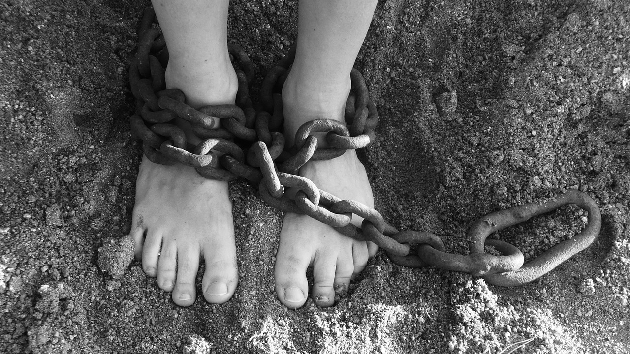 Picture of feet in shackles.