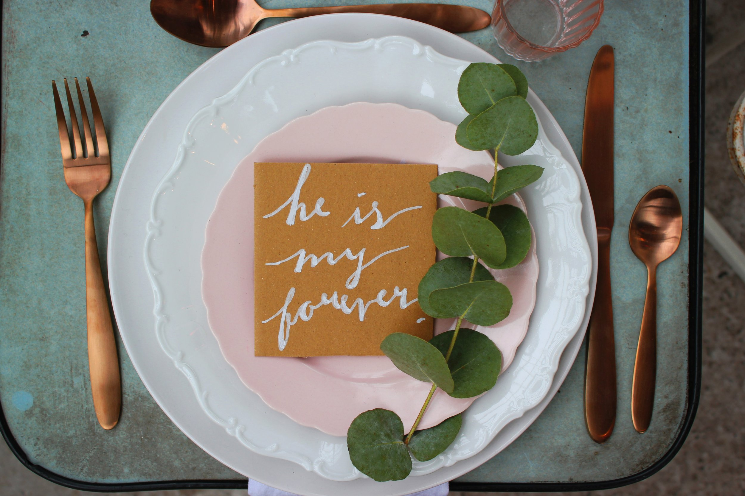 Modern and cool wedding day tablescape with copper cutlery