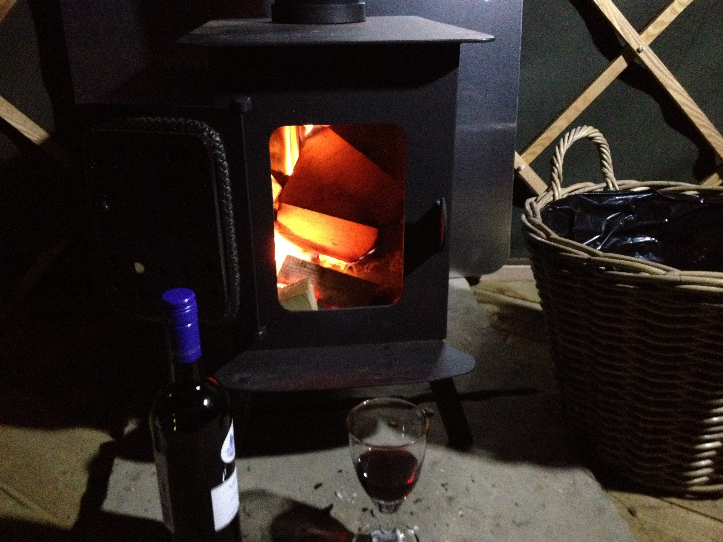 Yurt wine and stove.JPG