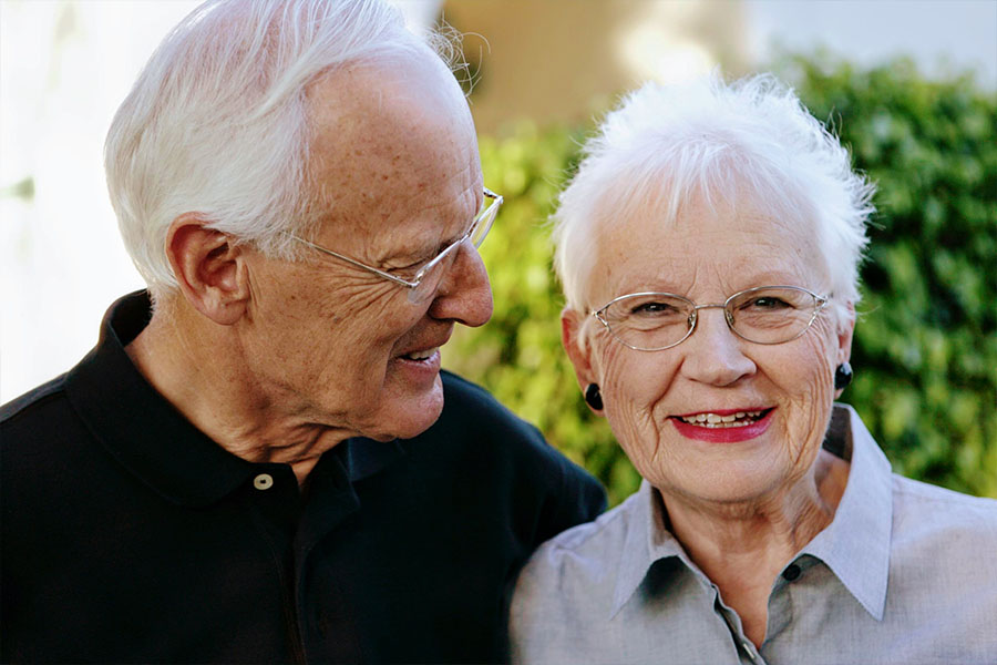 elderly couple smiling.jpg