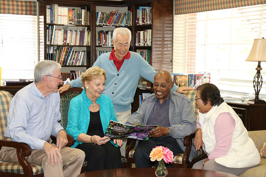 elderly group reading magazine inside library.jpg