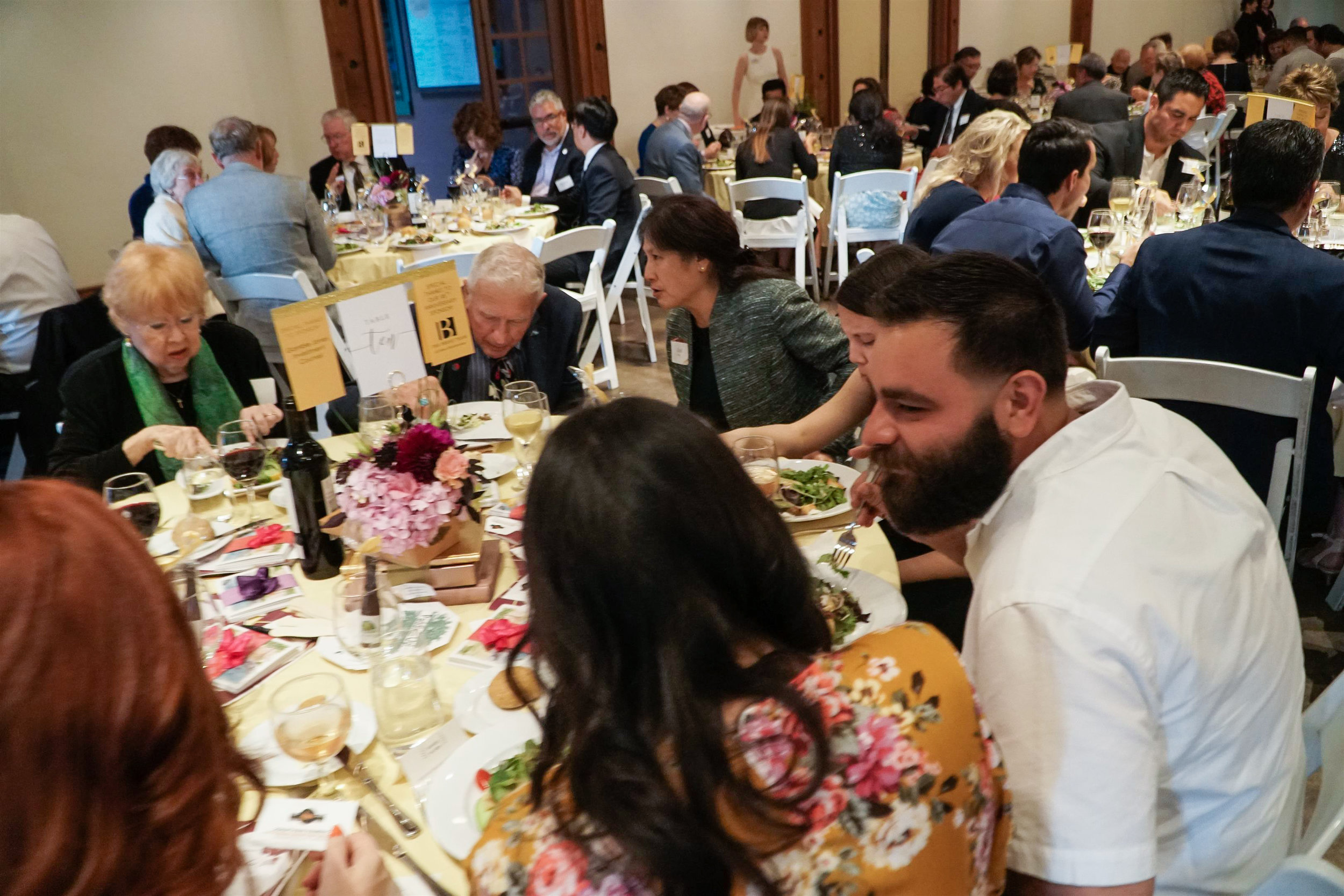 Guests chatting during Gala dinner.