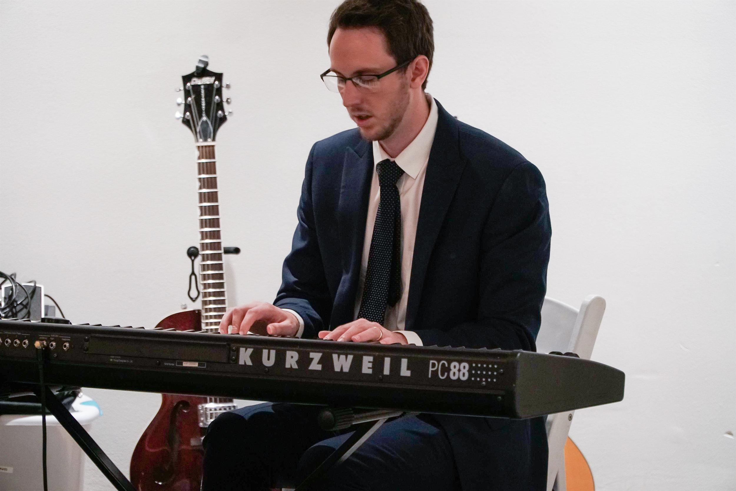 Musician playing keyboard during dinner