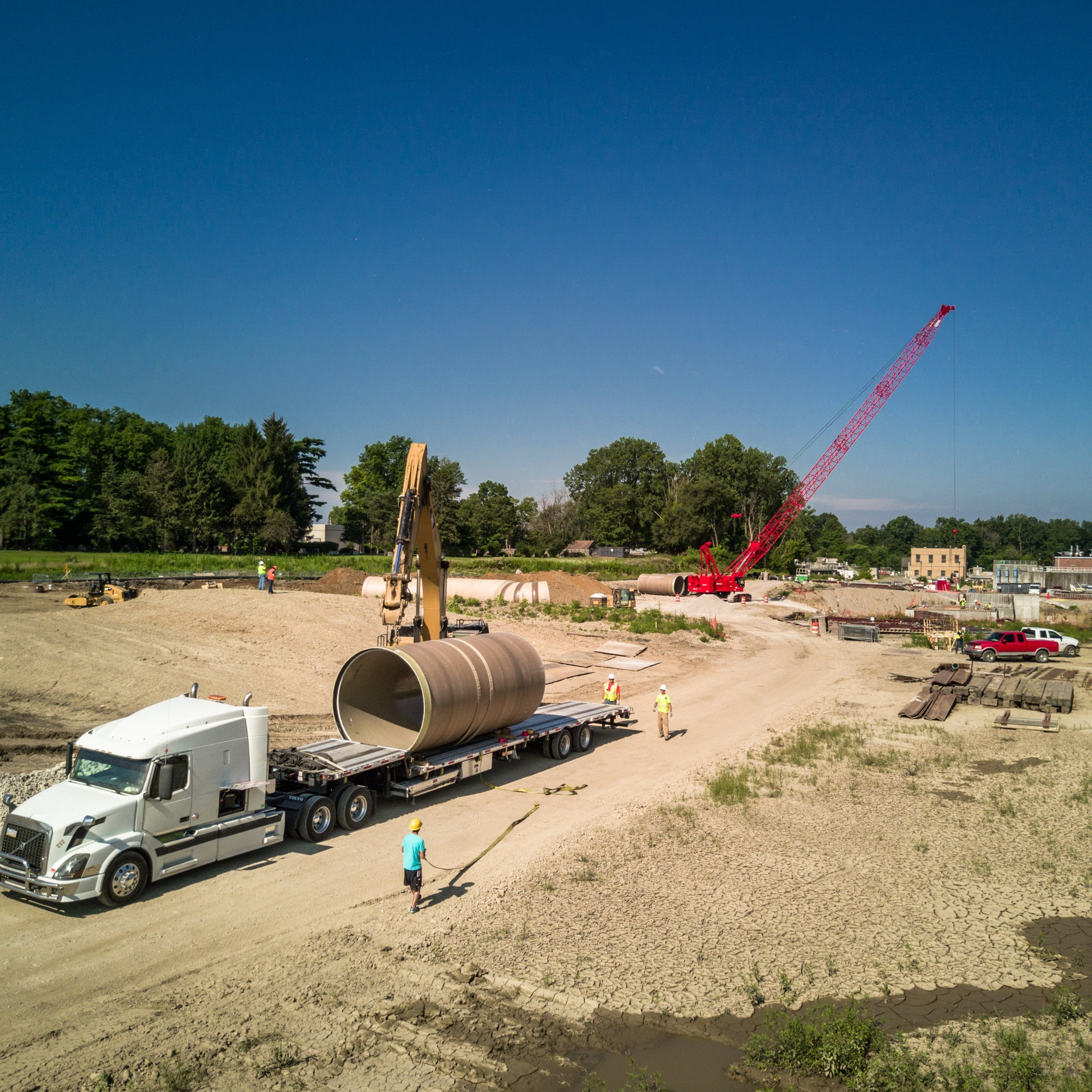 Site Work - Underground utilities, large diameter concrete pressure pipe, welded steel, PVC, HDPE fusion-weld, ductile iron, FRP, duct bank, deep excavations, engineered sheeting systems, open basin construction, pond and landfill construction, landfill closure, constructed wetlands