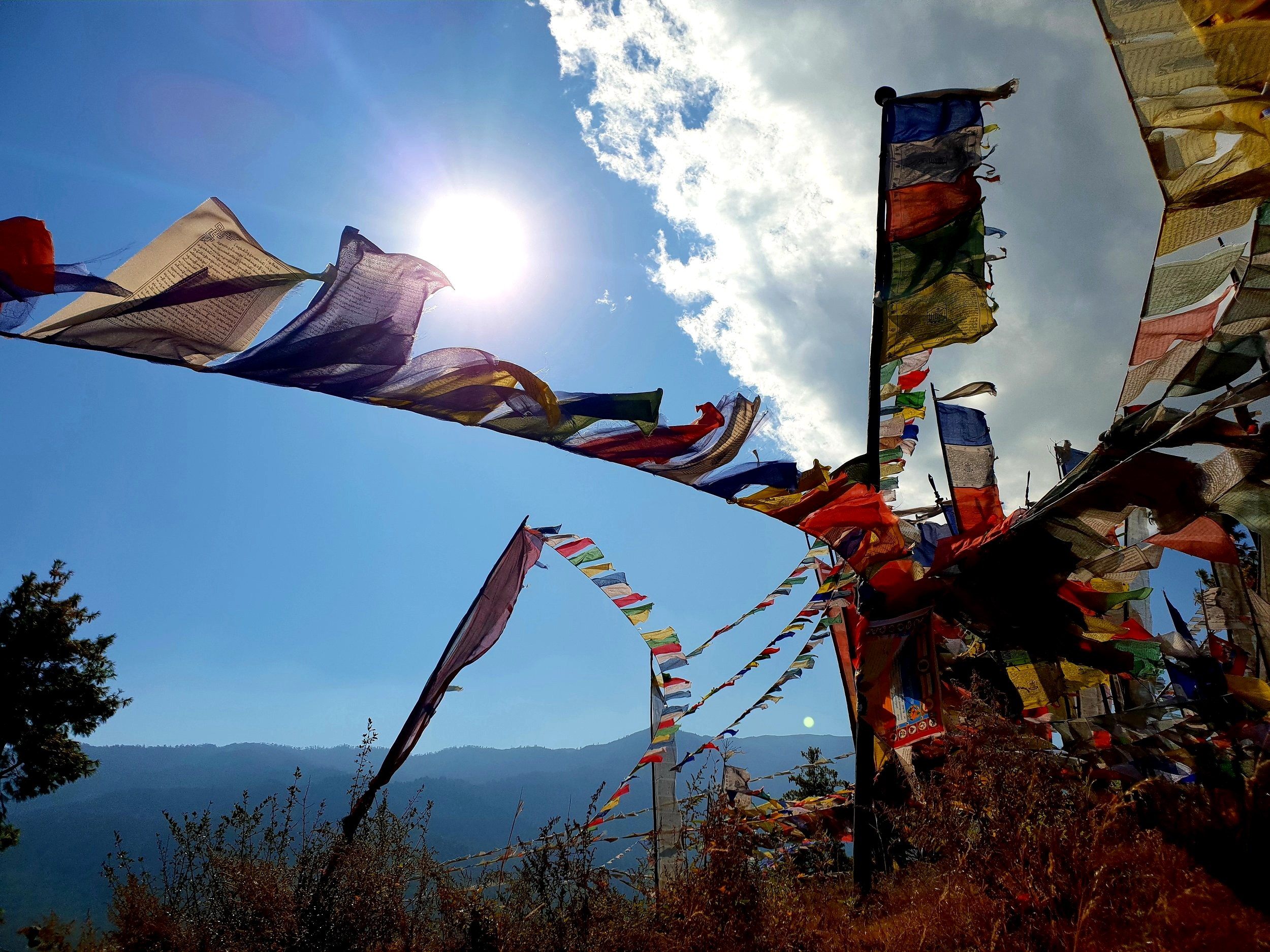 Prayer flags are a common sight all over the hills of Bhutan. A bit like a better version of bunting (strange word).