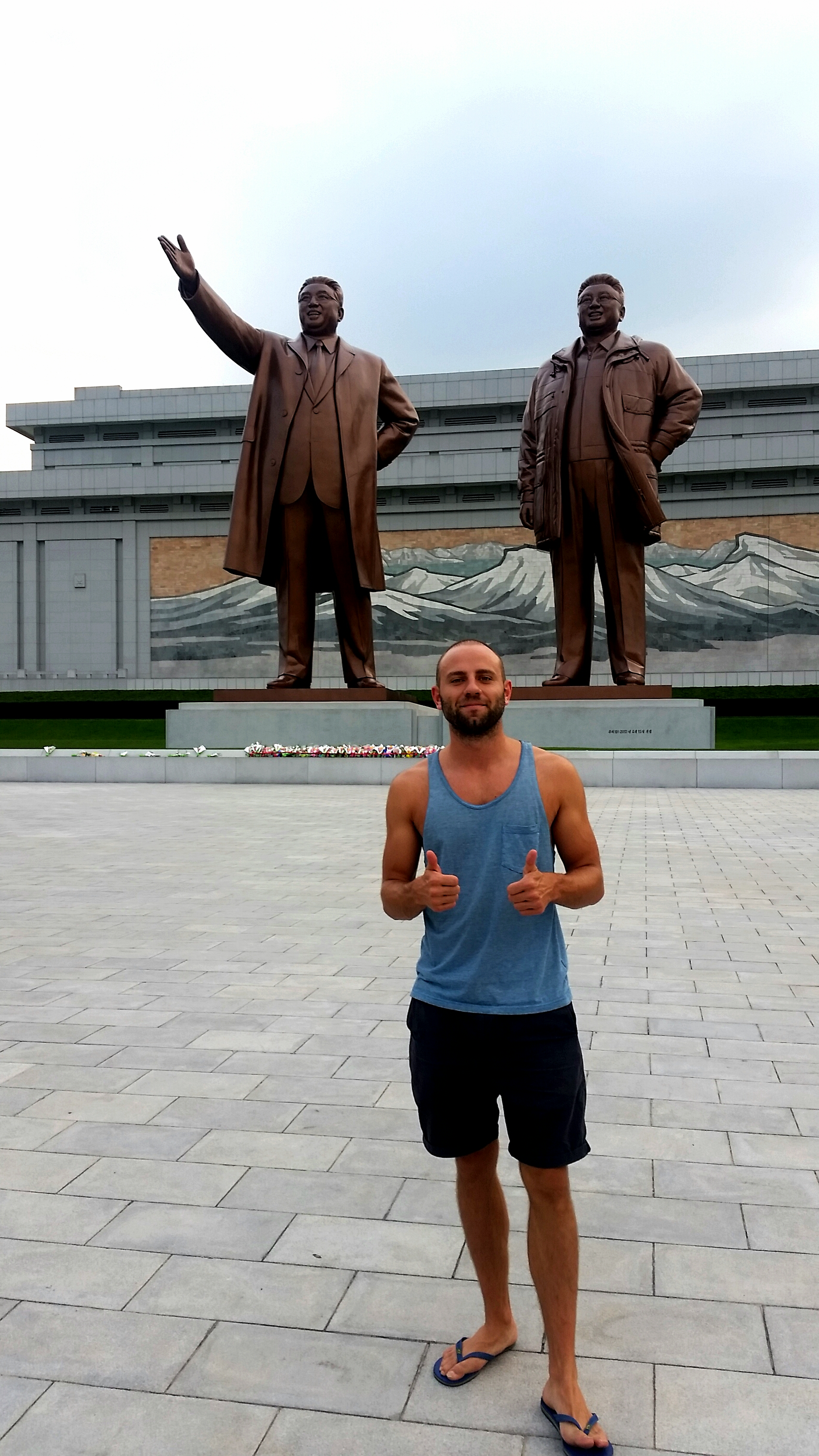 Orange human stands next to giant bronze eternal leaders. If countries were measured by the size and quantity of statues, then DPRK would be right up there with the best! Alas, they are not. Frustratingly, things like access to sanitation and food are considered more important.