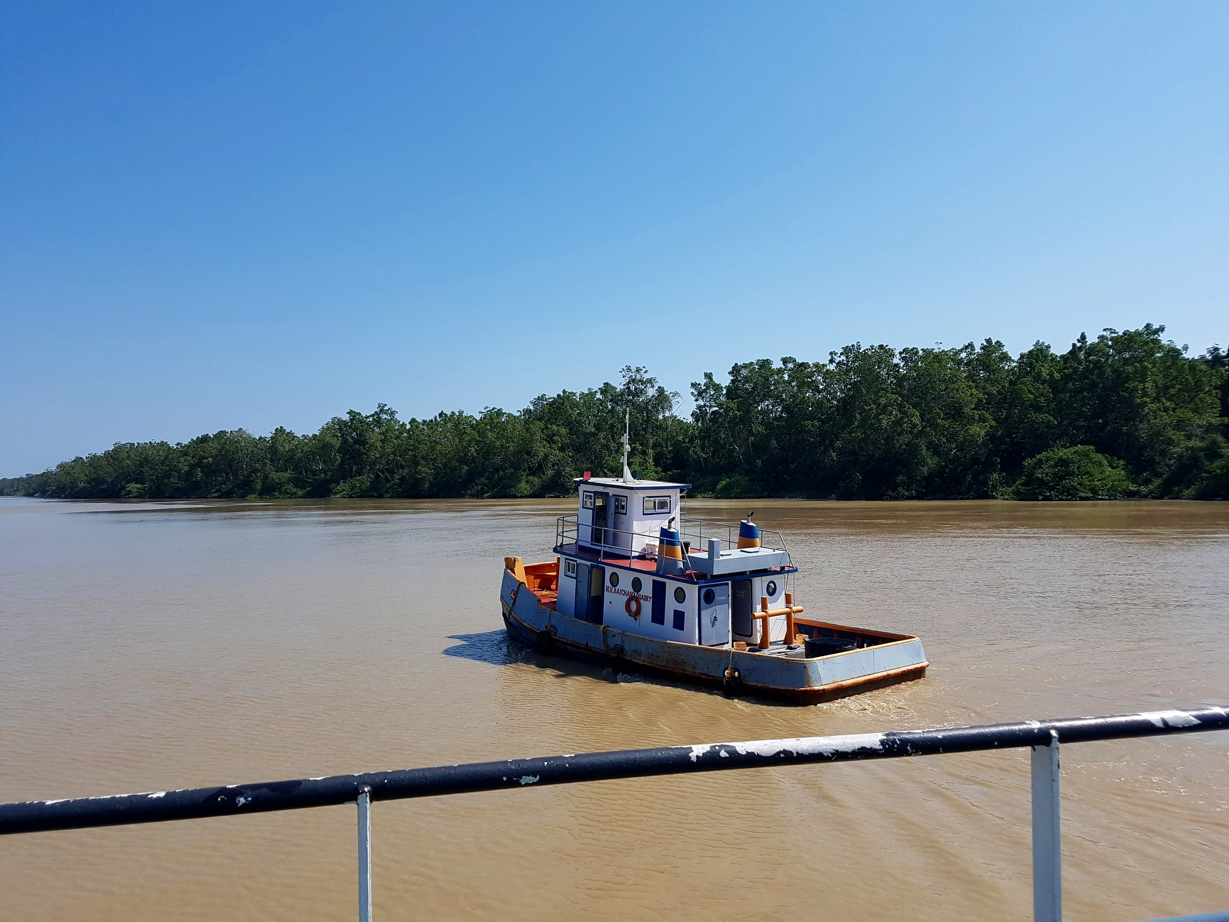 Less a tug boat, more a bumper boat which shoved our ferry across the border into Guyana.