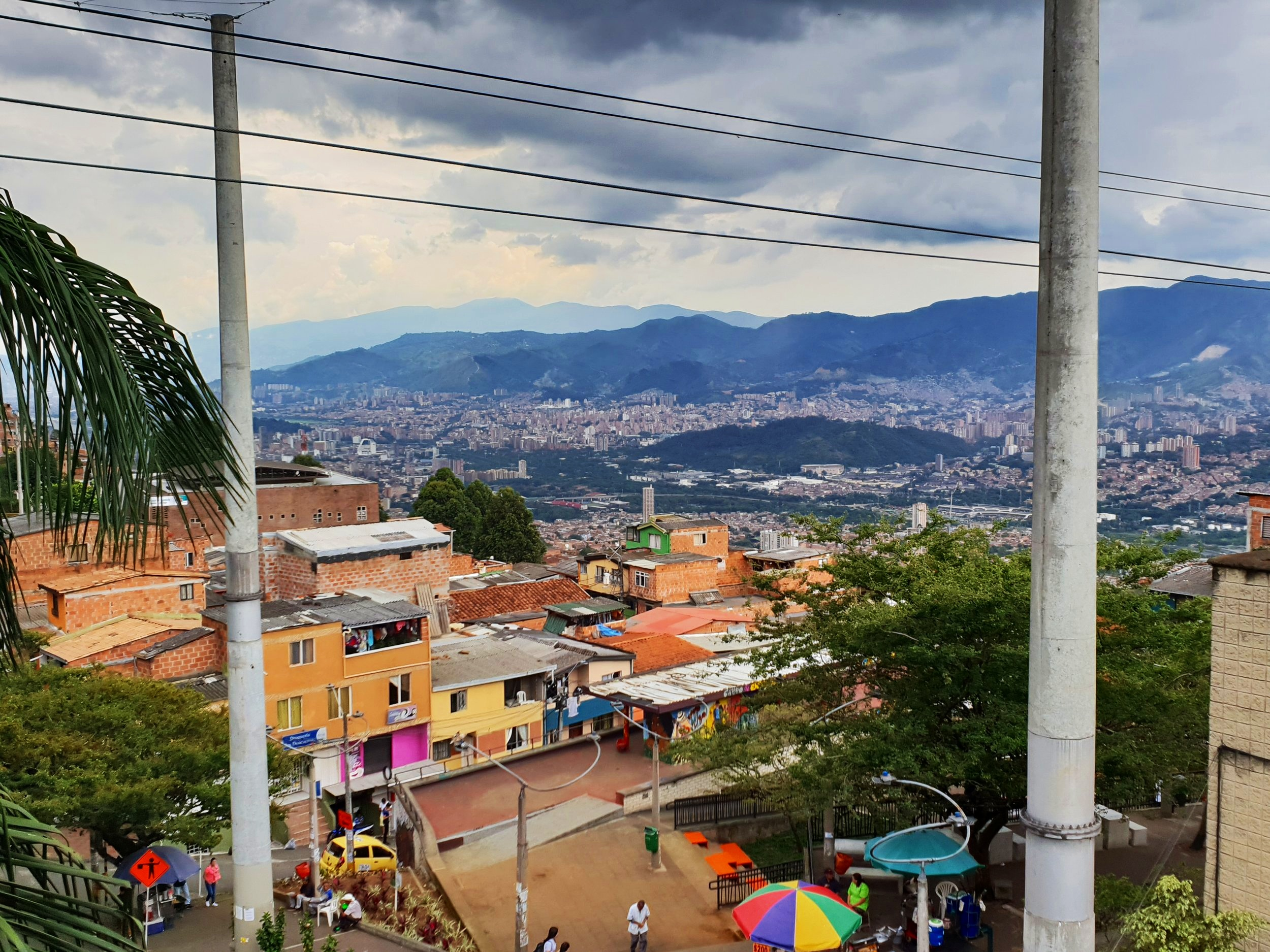 As intrepid travellers, we ventured into the barrios of Medellin….In a concealed cable car, before finding refuge in a rooftop bar, where this picture was taken.