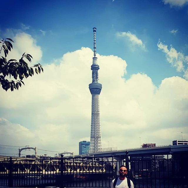 """📌 Japan - Country 46. . The Tokyo Sky Tree is second tallest structure in the world, after the Burj Khalifa in Dubai. Given that it stands in one of the most earthquake-prone major cities on earth, it's a fairly impressive feat. Like most supertall buildings globally, the construction of it was based on the idea that whoever has the biggest building is """"the best"""". It's 35 degrees here, with 60% humidity. Hence the facial expression like I've just been delivered bad news. . . . #chasing193 #travelerscenturyclub #thetravellingape #dailywanderlust #wanderlustdaily #chasing195 #travelsolo #everycountryintheworld #nomadmamia #instatravel #tokyotravel #traveltokyo #brutalism #concrwte #japantravel #landoftherisingsun #tods #harajukutravel #japanarchitecture #skytree #tokyoskytree #skyscraper #twopricks"""
