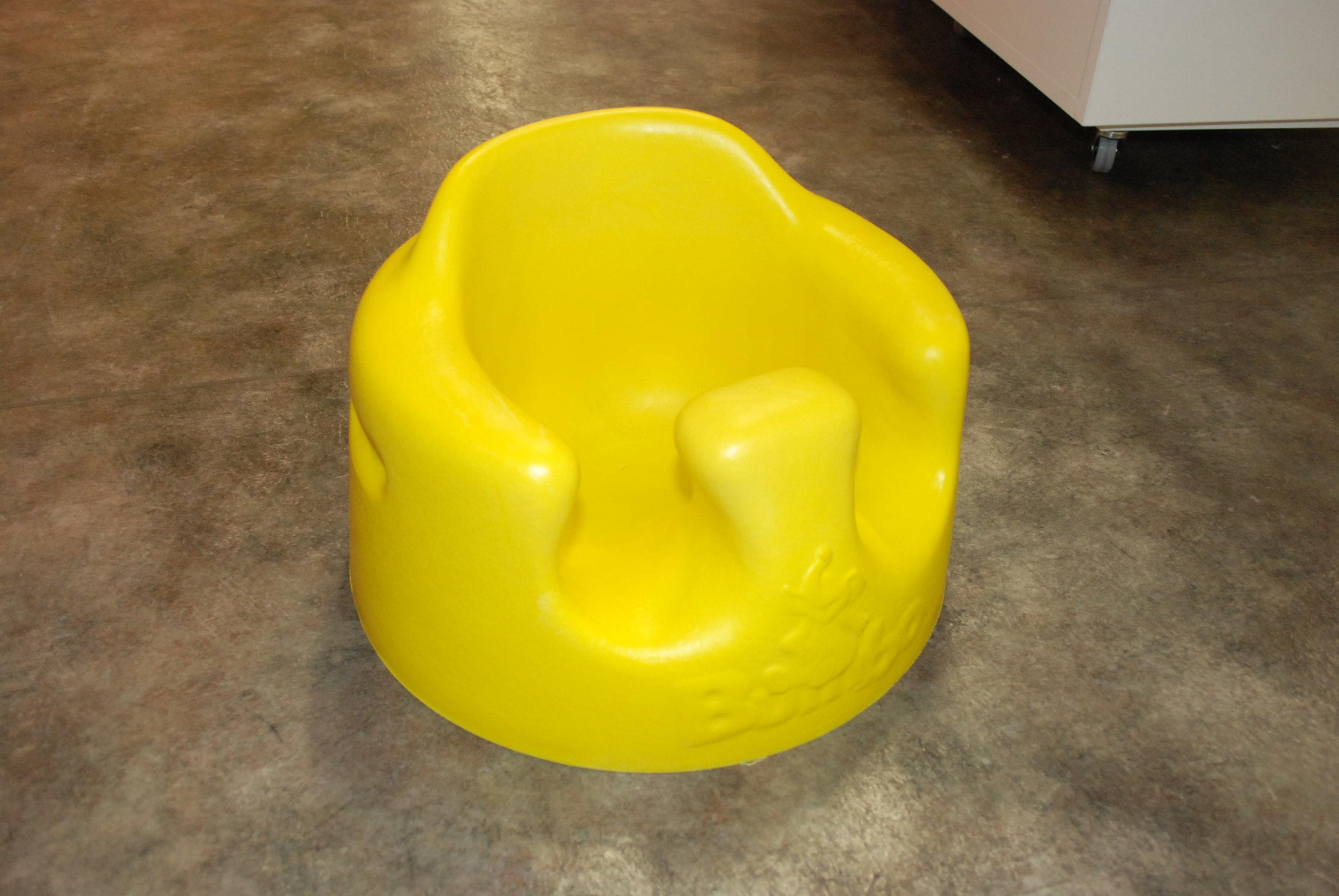 Passivt sittande med rund rygg